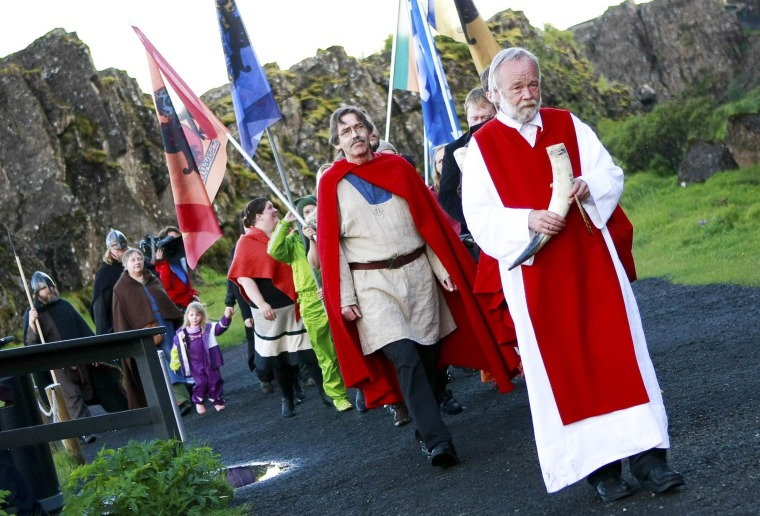 Image: The high priest of the Asatru Association Hilmarsson leads a procession of Asatru Association at Pingblot (Thing blot)