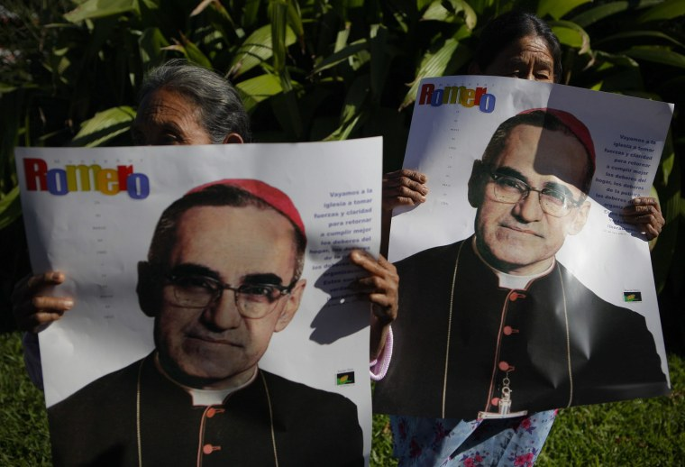 epa04531694 Victims of the armed conflict in El Salvador hold posters showing the image of late archbishop Oscar Arnulfo Romero, during a protest march in San Salvador, El Salvador, 16 December 2014. The protest is against the decision of the Mayor to name a street with the name of the deceased Army major Roberto D'Aubuisson, allegedly the mastermind of the killing in 1980 of Romero in San Salvador.  EPA/Oscar Rivera