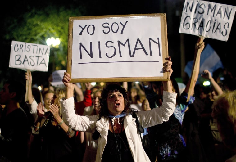 """Image: A demonstrator holds a sign that reads in Spanish """"I am Nisman"""" during a protest sparked by the death of special prosecutor Alberto Nisman, outside the government house in Plaza de Mayo in Buenos Aires, Argentina"""