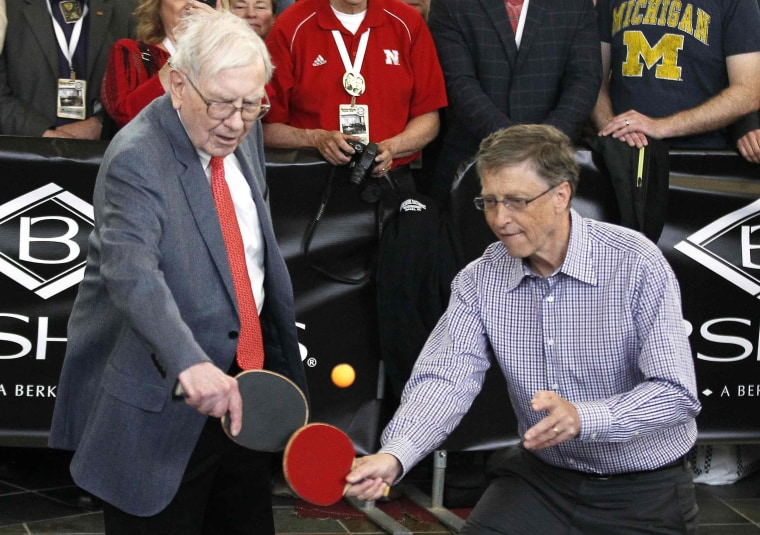 Image: Berkshire Hathaway CEO Warren Buffett plays table tennis with Microsoft Chairman Bill Gates in Omaha