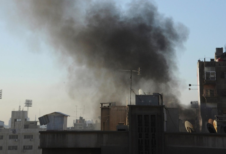 Image: Smoke rises from a site hit by rockets in Damascus