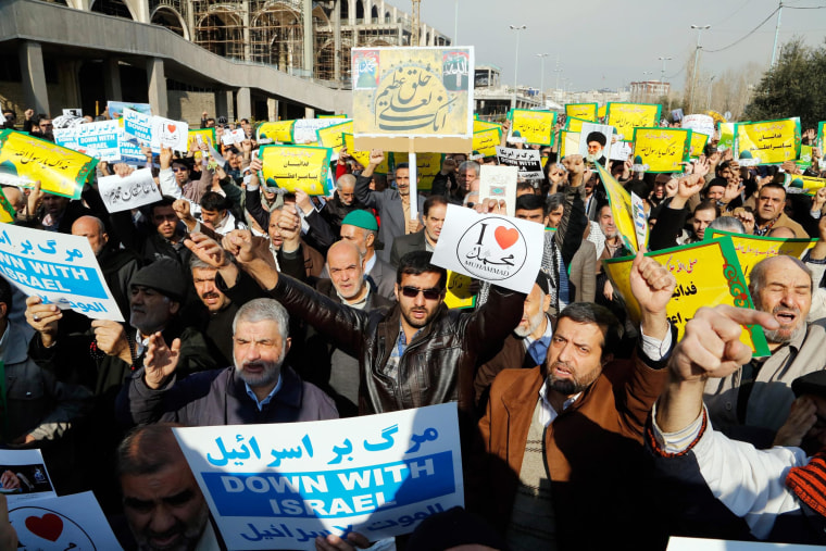 """epa04578552 Iranians hold placards reading in Farsi 'Muhammad, we sacrifice our lives for you' during a demonstration condemning decision by controversial French magazine, Charlie Hebdo, to publish a depiction of the Prophet Muhammad, follwoing Friday prayers, Tehran, Iran, 23 January 2015. According to local reports demonstrators once again took to streets shouting slogans such as """"We love Muhammad"""" and """"Down with the Zionist France"""" even as the Iranian Government condemned the attack on the offices of Charlie Hebdo which left 12 members of staff dead, but also criticised the publication's choice to publish depictions of the Prophet, which in many modern interpretations of Islam is considered to be forbidden.  EPA/ABEDIN TAHERKENAREH"""