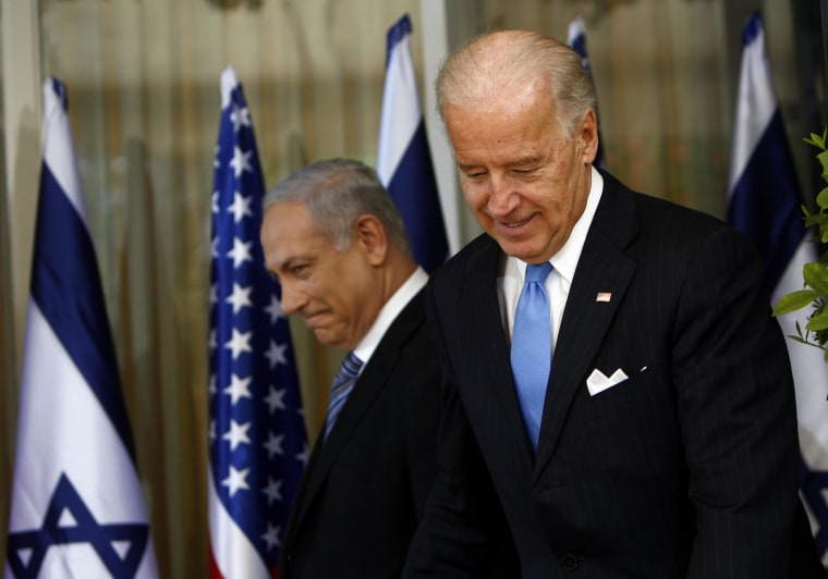 Image: Israel's Prime Minister Netanyahu walks behind U.S. Vice President Biden before their meeting in Jerusalem