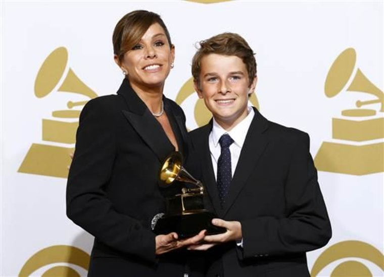 """Melissa Rivers poses with her son Edgar Cooper Endicott and the Grammy award for best spoken word album for her mother Joan Rivers """"Diary Of A Mad Diva."""""""