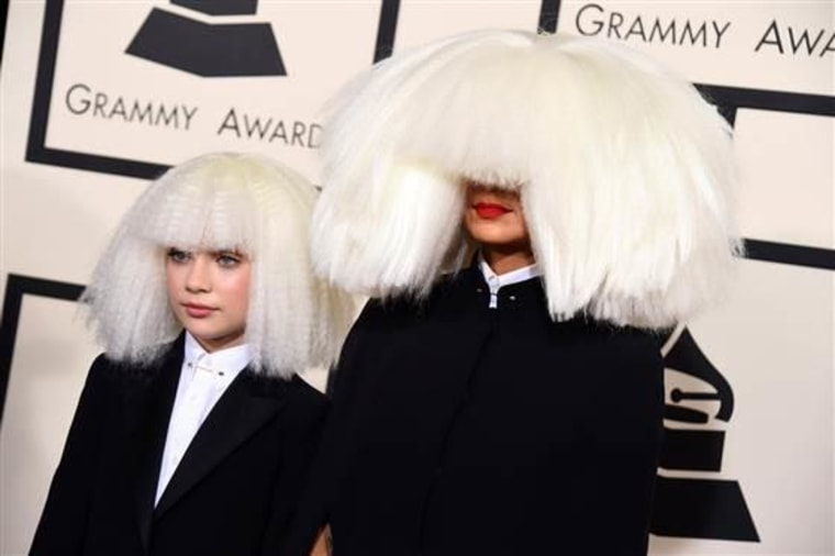 Sia (R) with dancer Maddie Ziegler who appears in her music videos.