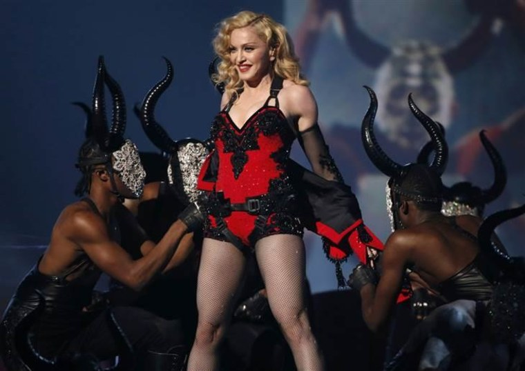 """Madonna performs """"Living for Love"""" at the 57th annual Grammy Awards on Feb. 8."""