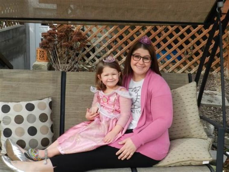 Terri and her daughter Kennedy, 4, who chose matching princess outfits for a Sunday dinner with friends.
