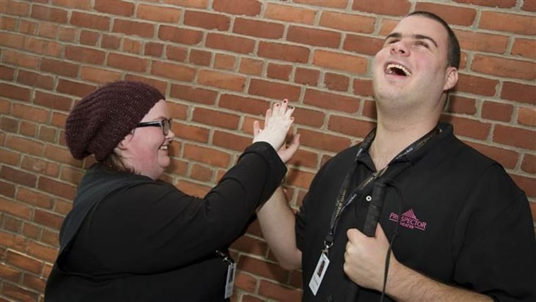 Katie Faughnan and Thomas Acocella high-five each other for a job well done.
