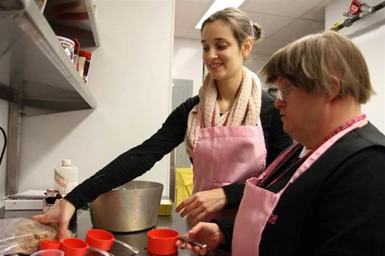 Ashley Shriver and Grace Kolf help create the Prospector's popular caramel corn.