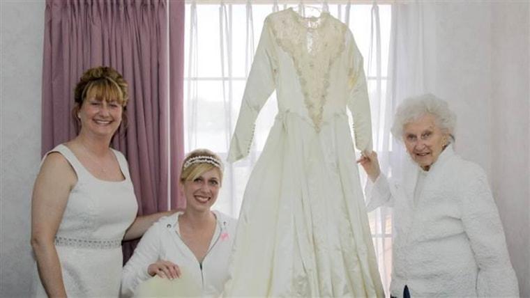 Cindy, Jackie, and Helene pose with their wedding dress.