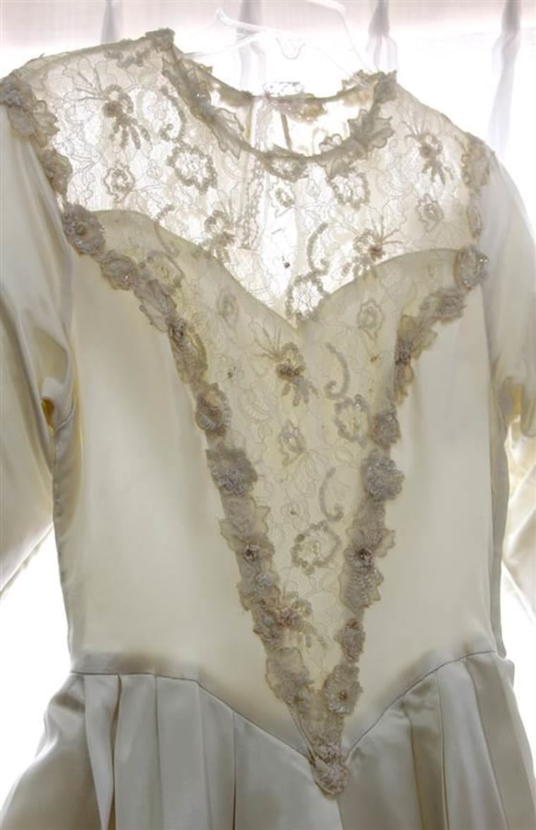 """A detail of the shared gown, which a clipping of Helene's wedding announcement describes as a """"bodice of lace, seed pearls and irridescent [sic.] sequins."""""""