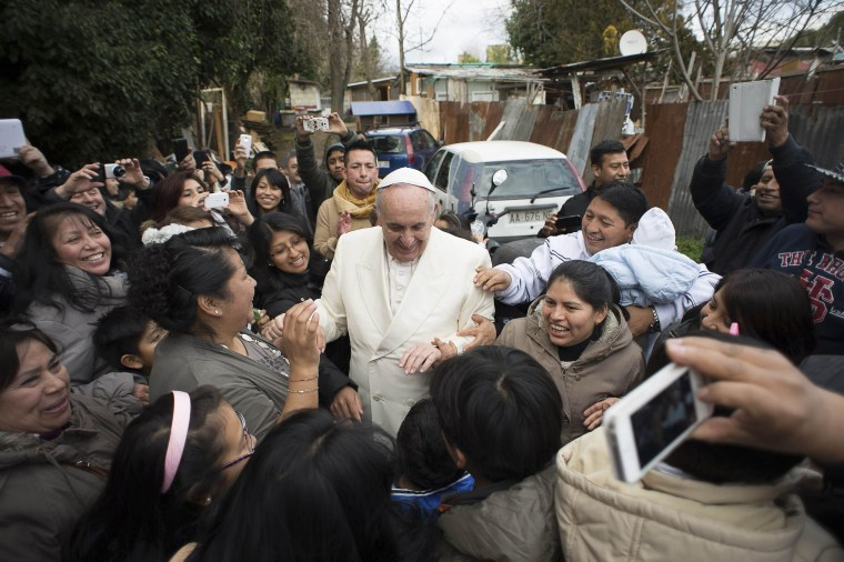 Image: Pope Francis visits a shantytown on the outskirts of Rome