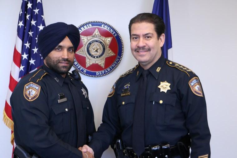 Deputy Sandeep Singh Dhaliwal with Sheriff Adrian Garcia.
