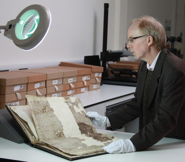 Mark Bateson, the Kent County Council Community History Officer, with the Magna Carta.
