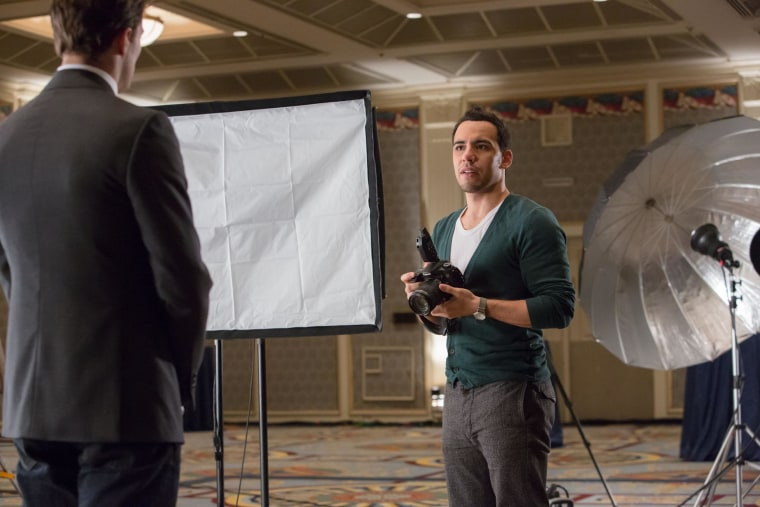 "In a scene from ""Fifty Shades,"" Victor Rasuk as Jose Rodriguez at a photo shoot with Jamie Dornan as Christian Grey."