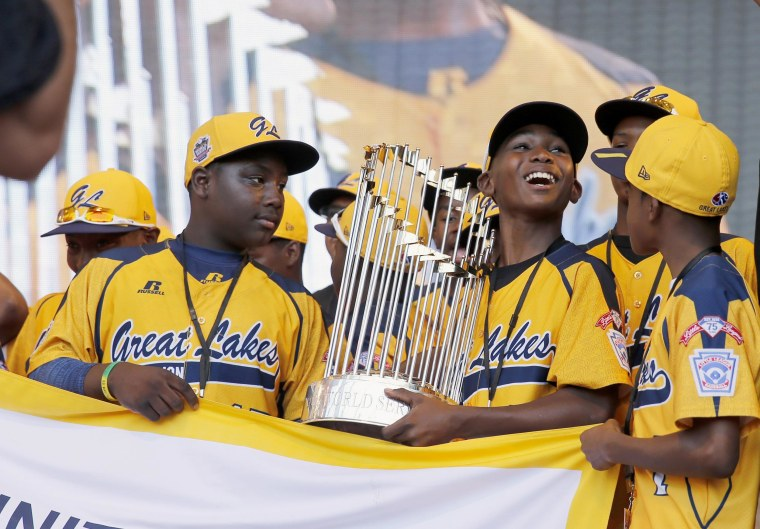 Members of the Jackie Robinson West Little League baseball team participate in a rally in Chicago celebrating the team's U.S. Little League Championship on Aug. 27, 2014.