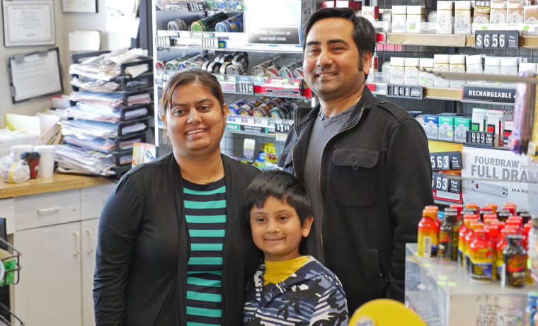 Chandra Siwakoti, owner of the Appletree Food Mart in Princeton, Texas, poses with his wife Smriti Acharya and son Aryan on Feb. 12 after it was announced that a winning Powerball ticket had been sold at the story.  When Chandra pulled up at the store in the early morning, he saw the news trucks and reporters and thought he had been robbed.