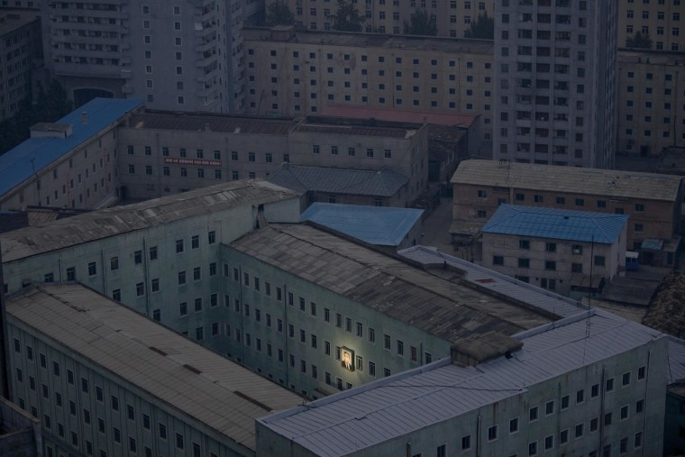 Image: File photo shows a picture of North Korea's founder Kim Il-sung on a building in the capital Pyongyang