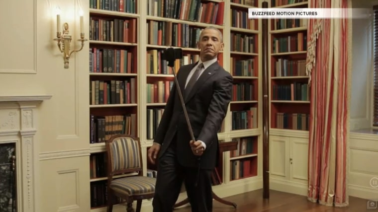 """Still shot of President Obama using a selfie stick from Buzzfeed's """"Can I Live"""" video."""