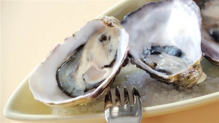 Fresh natural oysters in their shells ready to serve.
