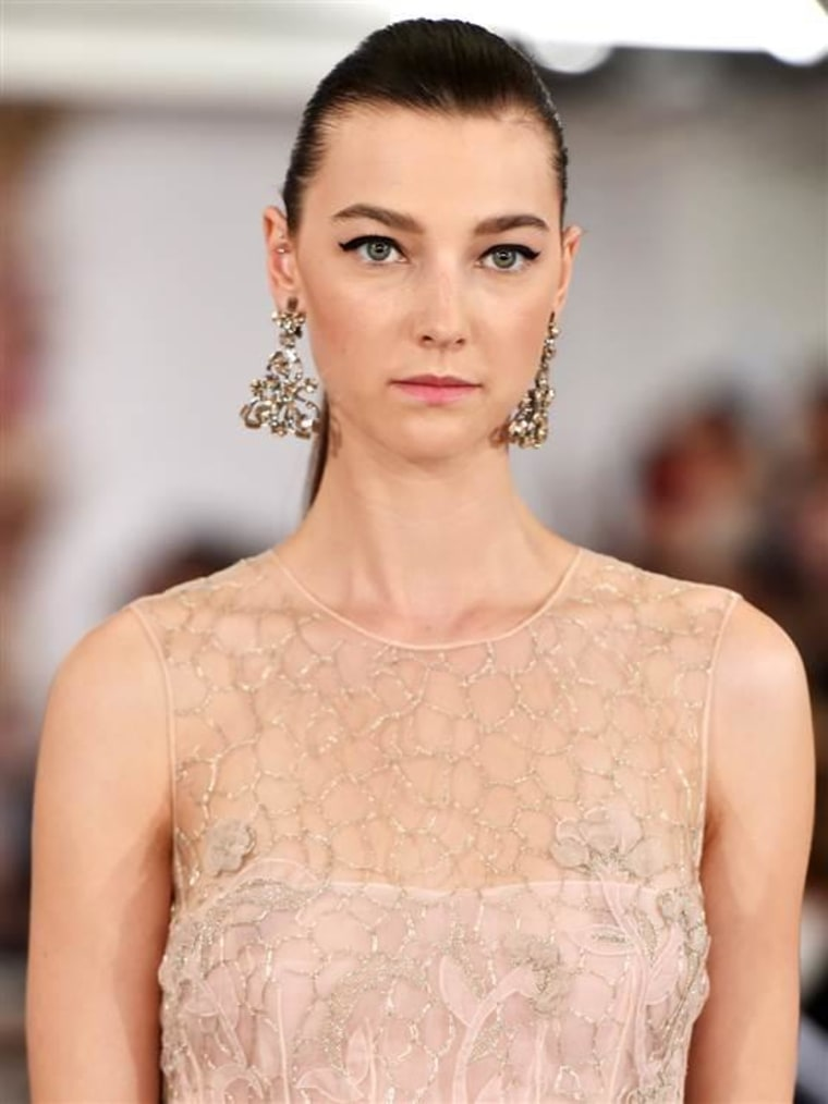 A model walks the runway at the Oscar De La Renta fashion show during Mercedes-Benz Fashion Week Spring 2015 on September 9, 2014.