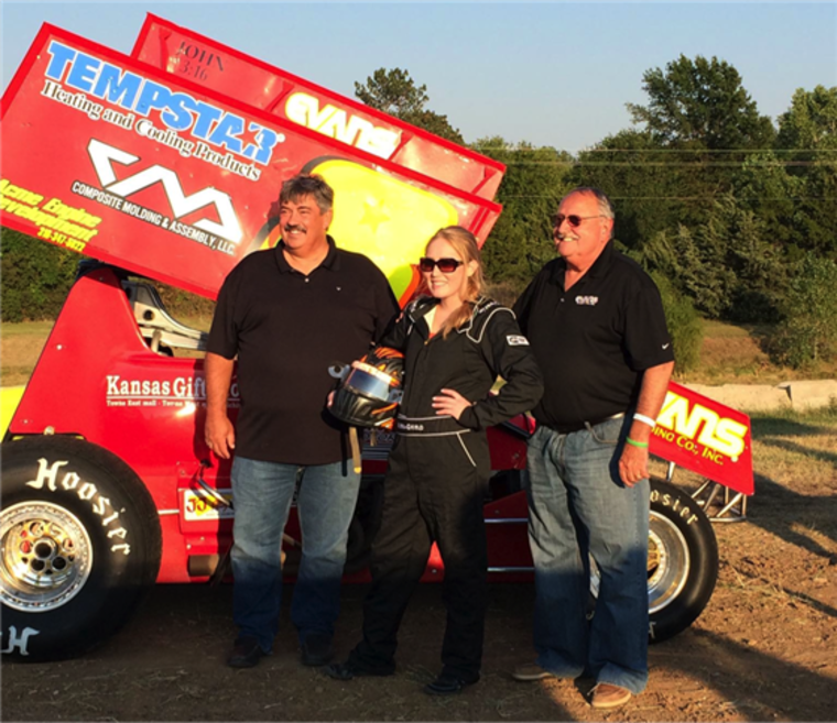 Race track owners Jeff Whitehead and Bill Johnson with Justine Komin at 81 Speedway in Park City, Kansas.