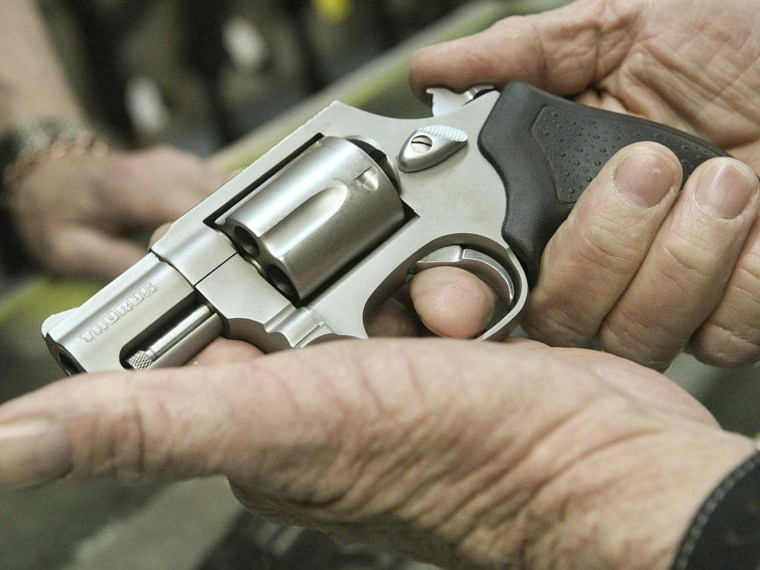 """Ray Scott looks at a Tarus .38 Special Revolver, Thursday at Tommy """"Hoss Fly"""" Atchison Guns & Trade, Inc. in Midland, Texas."""