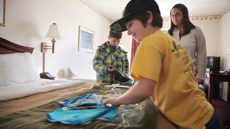 Kelley Ericson and her two kids moved into a hotel on short notice after their apartment building suffered a partial roof collapse from heavy snow in Portsmouth, N.H.