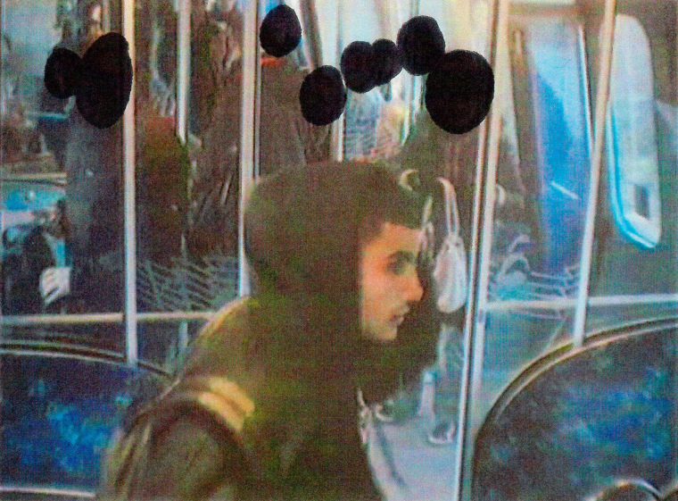 Image: An image released by Danish police shows Omar Abdelhamid Hussein on a subway train in 2013