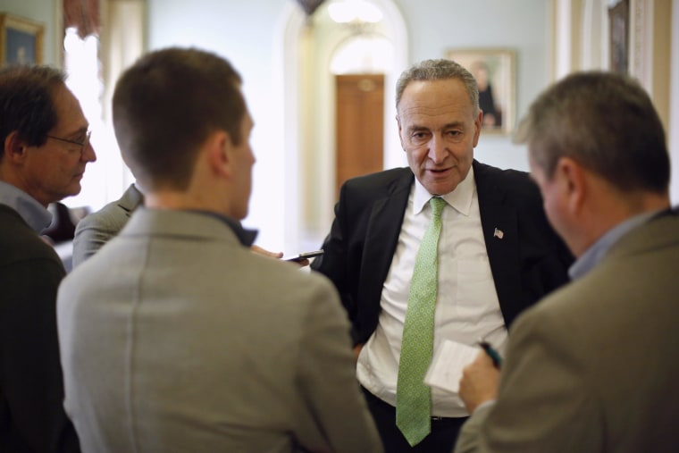 U.S. Senator Chuck Schumer (D-NY) speaks with reporters during a break from a long series of votes, many on procedural matters or to confirm members of the Obama administration, at the U.S. Capitol in Washington December 13, 2014. The Senate passed a five-day extension of federal funding on Saturday, staving off a government shutdown and buying lawmakers more time to resolve a fight over a longer, $1.1 trillion spending bill led by Tea Party firebrand Ted Cruz.   REUTERS/Jonathan Ernst    (UNITED STATES - Tags: POLITICS BUSINESS)