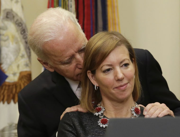Image: United States Vice President Biden talks to Stephanie Carter, wife of new US Secretary of Defense in Washington
