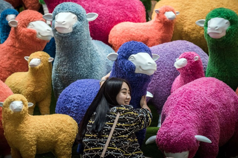 Image: A sheep installation displayed in a Hong Kong shopping mall for the Chinese New Year celebrations