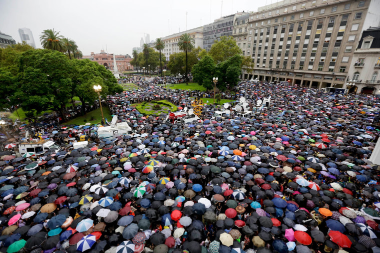 Image: People gather in the iconic Plaza de Mayo