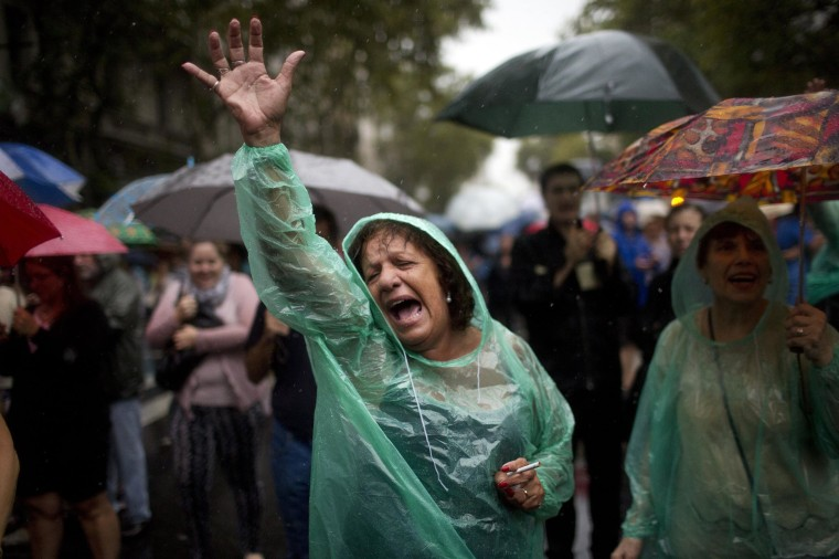 Image: A protester chants anti-government slogans during a march