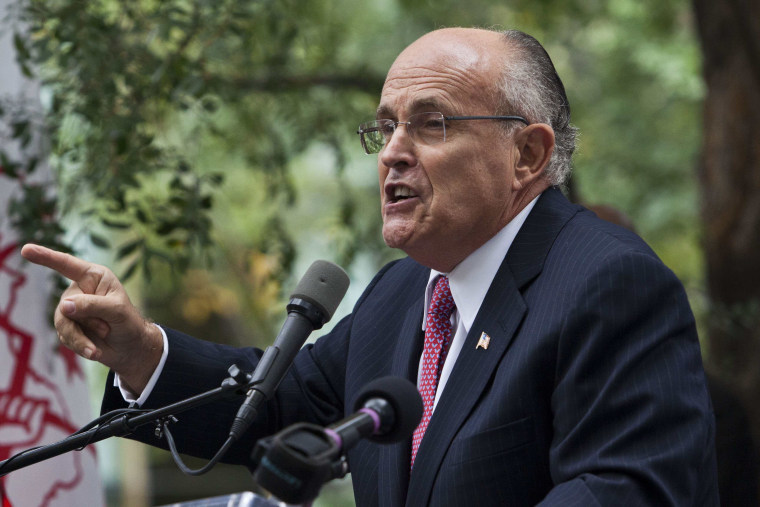 Image: Former New York mayor Giuliani speaks at protest organized against presence of Iranian president Ahmadinejad at U.N. General Assembly in New York