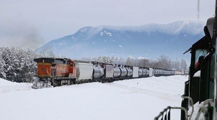 Image: A BNSF oil train heads west through Whitefish, Montana.
