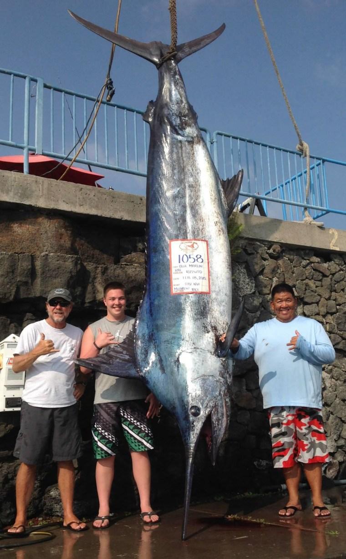 Image: Kai Rizzuto, 16, lands a 1,058-pound blue marlin off Kona, Hawaii.