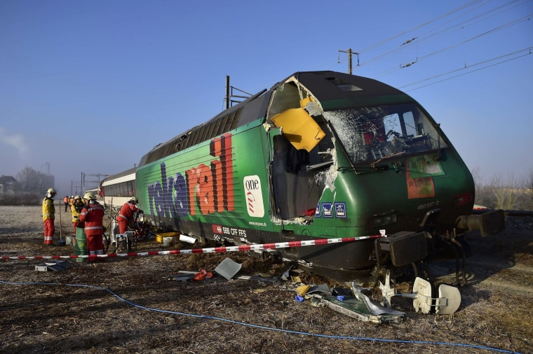 Image: Rescue workers inspect the site of a train crash