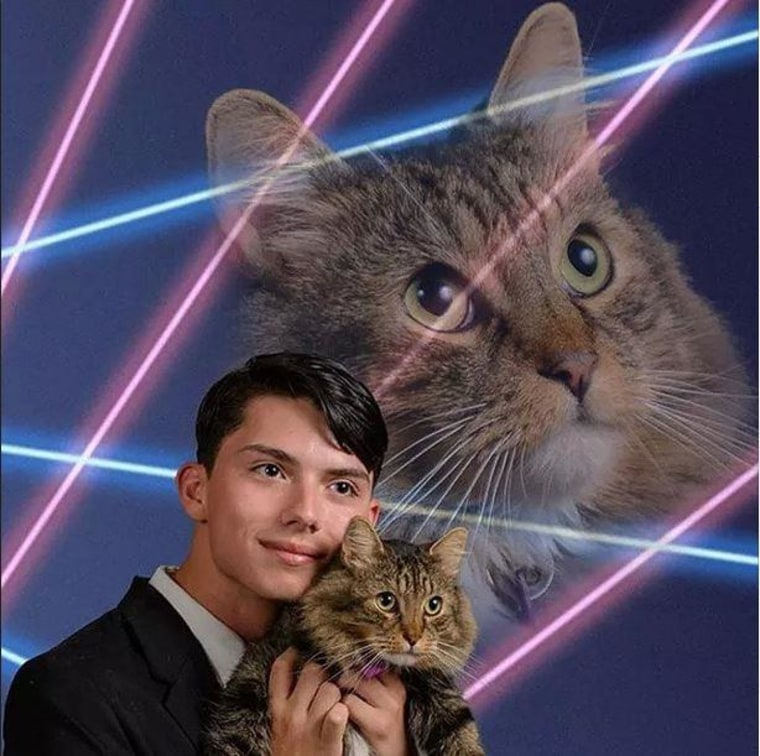 Draven Rodriguez in a yearbook photo with his cat.
