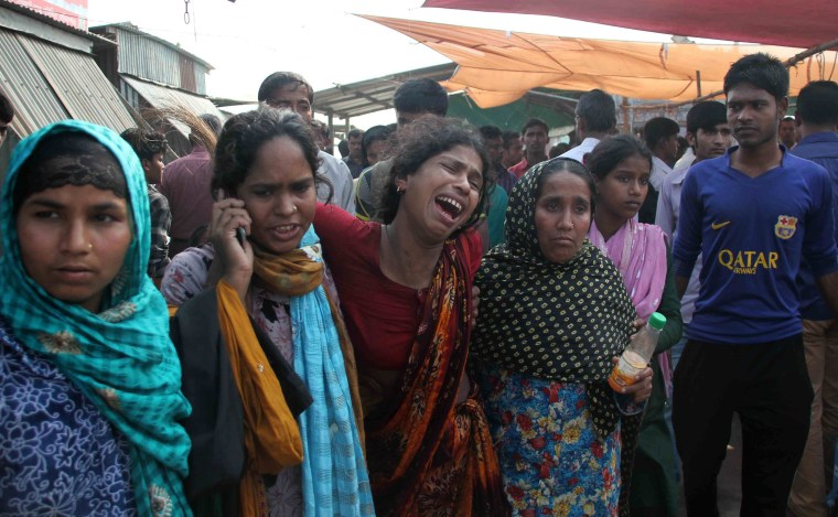 Image: Bangladesh relatives cry as they mourn the death of ferry accident victims