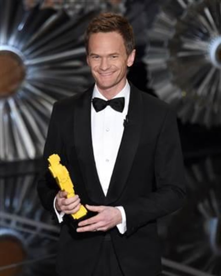 Host Neil Patrick Harris holds a Lego Oscar statuette at the Oscars. (Photo by John Shearer/Invision/AP)