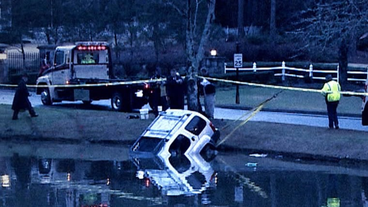 Emergency personnel haul Shanell Anderson's SUV out of a pond near Atlanta. They arrived too late to save her life.