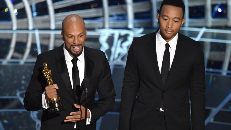 Common, left, and John Legend accept the Academy Award for best original song