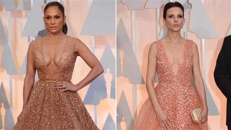 Jennifer Lopez (L) and Robert Duvall's wife Luciana picked nearly identical gowns for the Oscars red carpet.