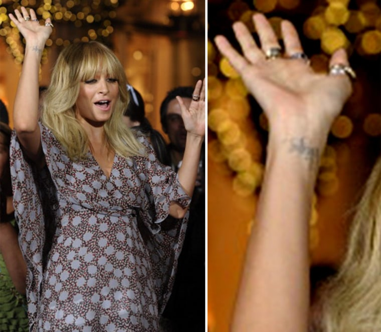 Nicole Richie and the tattoo she wishes she hadn't gotten.