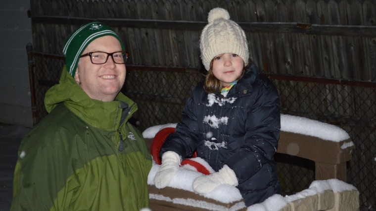 Dennis Rhoney and his daughter, after playing in the snow.
