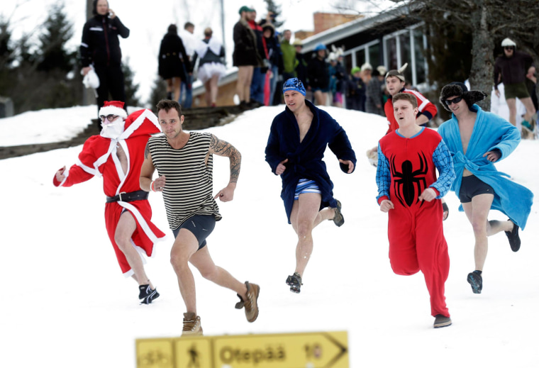 Image: Participants run to the nearest sauna in Otepaa, Estonia