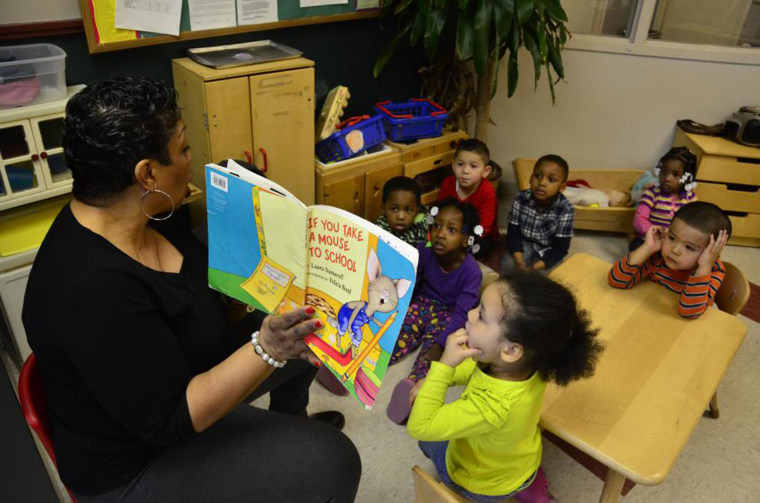 Image: Teacher reading aloud with children
