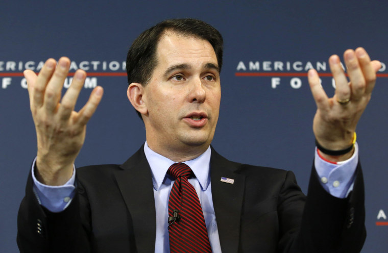Wisconsin Governor Scott Walker (R-WI) participates in a panel discussion at the American Action Forum in Washington, in this January 30, 2015 file photo. When Walker, a potential Republican presidential candidate, travelled on a trade mission to Britain last week, he brought along top officials from his economic development agency to help drum up jobs. It's a task they have struggled to accomplish at home.   REUTERS/Yuri Gripas/Files (UNITED STATES - Tags: POLITICS)