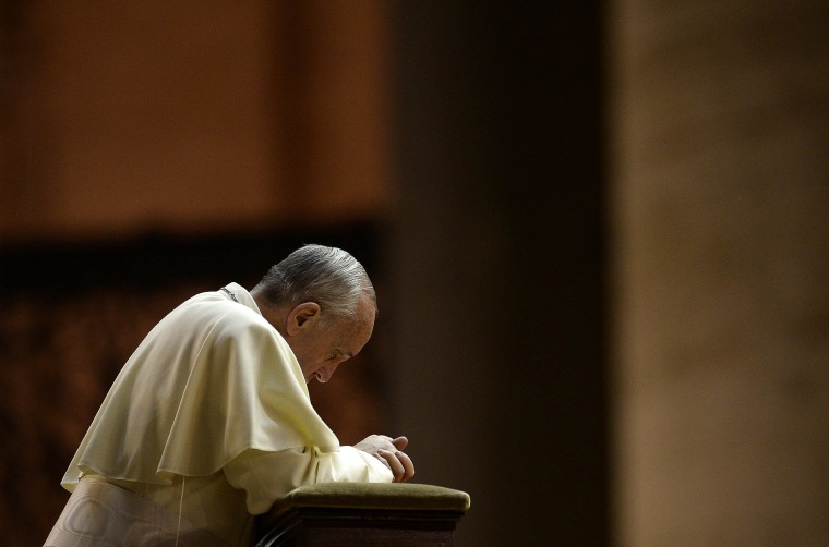 Pope Francis prays in Saint Peter's Square at the Vatican on September 7, 2013.